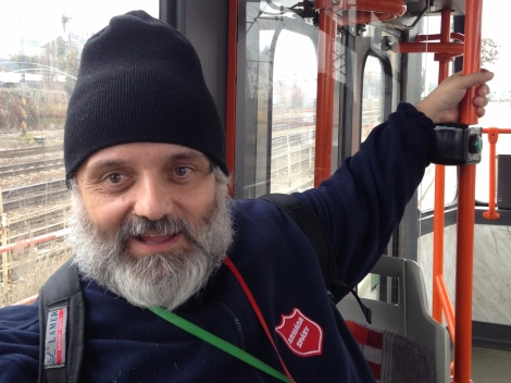 Pragulic guide Robert Pochop rides the tram in Prague.